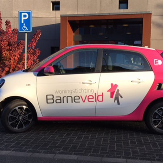 Woningstichting Barneveld, autobelettering riko reclame Ede