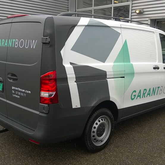 Autobelettering deelwrap Garantbouw Lunteren. Riko Reclame Ede , www.riko-ede.nl
